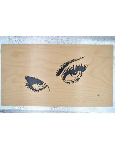Table of eyes of woman singed in birch.