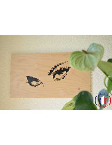 Painting of the eyes of a woman chantourné in birch.